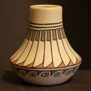 Feather and geometric design on a low-shouldered polychrome jar