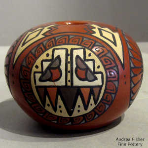 Feather, stormcloud medallion and geometric design on a polychrome seed pot
