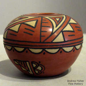 Kiva step, cloud and geometric design on a polychrome seed pot