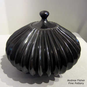 Carved black lidded melon jar