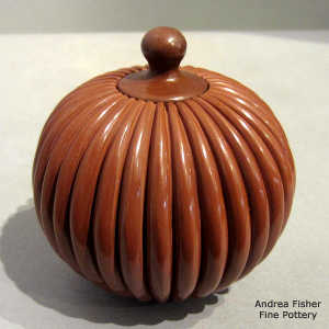 Lidded red jar carved with a melon design