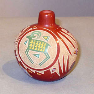 Sgraffito and painted ram and geometric design on a miniature polychrome jar