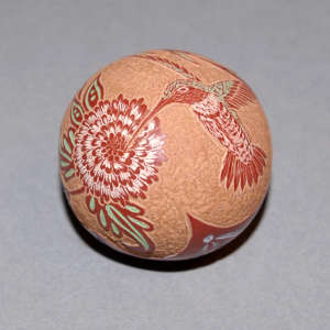 Sgraffito hummingbird, flower and geometric design on a polychrome seed pot