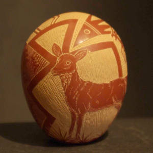 Sgraffito deer and geometric design on a red seed pot