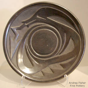 Avanyu design carved into a black plate