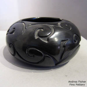 Geometric design carved into a black bowl