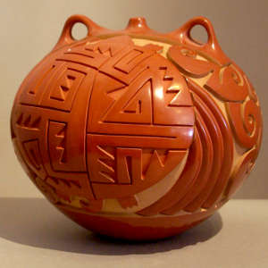 Geometric design carved into a red canteen