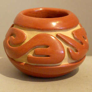 Carved red jar with exceptional polish