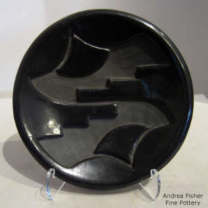 Geometric design carved into a black plate