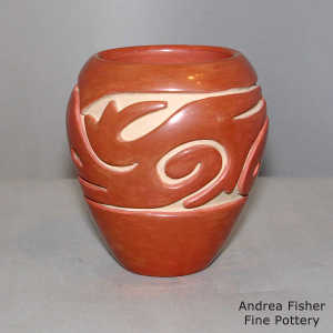 A geometric design carved into a red jar