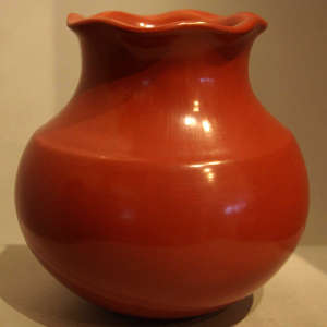 Fluted rim on a polished red jar