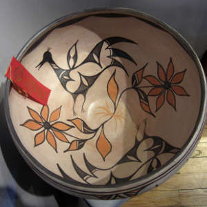 Birds and floral design inside and geometric design outside on a polychrome dough bowl