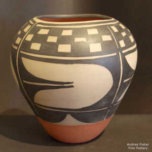 Black and white geometric design on a polychrome jar