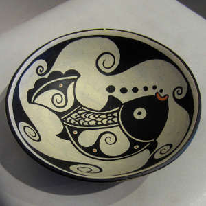 Fish and water designs inside and water design outside on a polychrome bowl