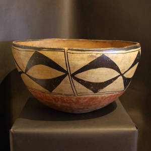 Geometric design on the outside of a large polychrome dough bowl