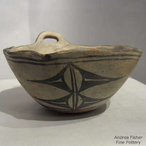 Geometric design and faceted rim on a polychrome bowl
