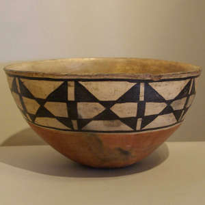 Leaf design inside and geometric design outside on a polychrome bowl