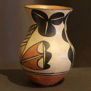 Cloud, water and geometric designs on a polychrome vase