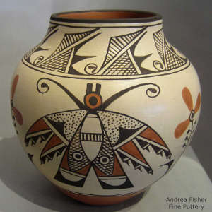 Moth, floral and geometric designs on a polychrome jar
