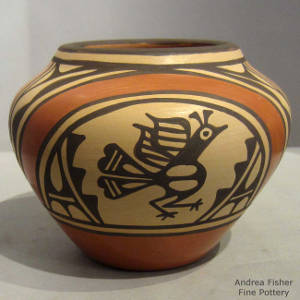 Cloud, roadrunner and geometric designs on a polychrome jar
