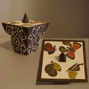 Insect and geometric design on a square, lidded polychrome jar