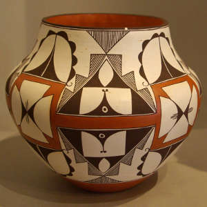 Shard, medallions and geometric designs on a polychrome jar