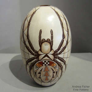 Spider and geometric designs on a polychrome seedpot