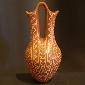 Sgraffito geometric designs on a red wedding vase