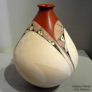 Sgraffito and geometric design on a thin-neck jar