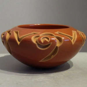 A geometric design carved into a red bowl