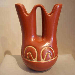 Geometric design carved into a red wedding vase