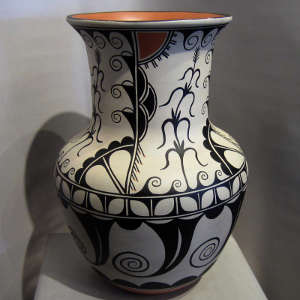 Corn, cotton and water design on a polychrome umbrella stand